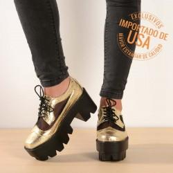Zapatos dorados tipo tanque
